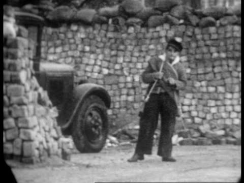 vídeos de stock e filmes b-roll de soldiers on trucks holding fists in the air / building barricades to defend madrid / digging holes and building walls / setting up air raid shelters - air raid