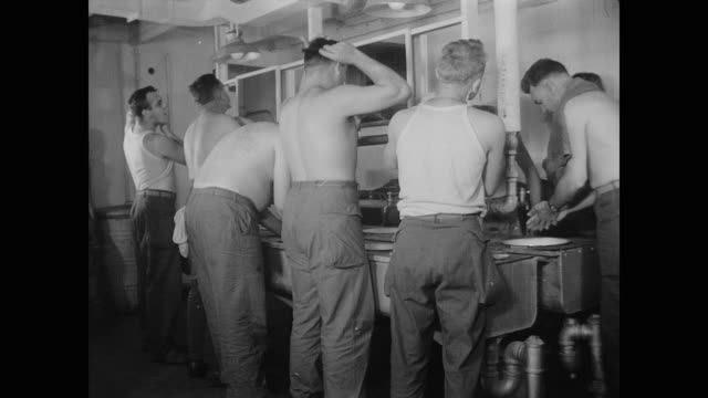 stockvideo's en b-roll-footage met soldiers on uss wakefield take advantage of showers and washing facilities - leger soldaat