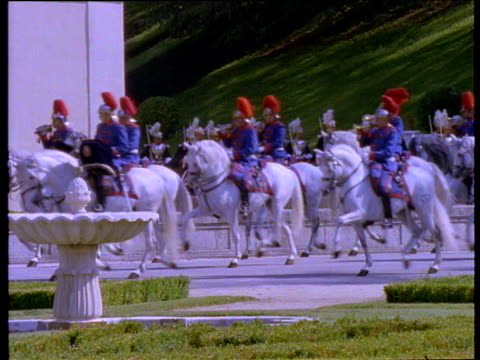 soldiers on white horses parade past building playing trumpets. - royalty stock videos & royalty-free footage