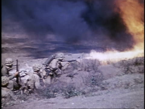 soldiers operating flame throwers / iwo jima japan - schlacht um iwojima stock-videos und b-roll-filmmaterial