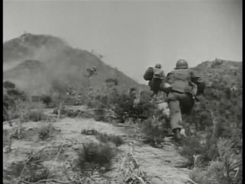 stockvideo's en b-roll-footage met us soldiers part of un forces making way up rural hill ws bazooka team firing rocket soldier in camouflage firing rifle the cold war troops - koude oorlog
