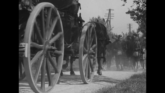 soldiers pass and civilians applaud from seats high on a wall behind /cu soldiers approach pass / a low angle view of a horsedrawn cart and the men's... - armored truck stock videos and b-roll footage