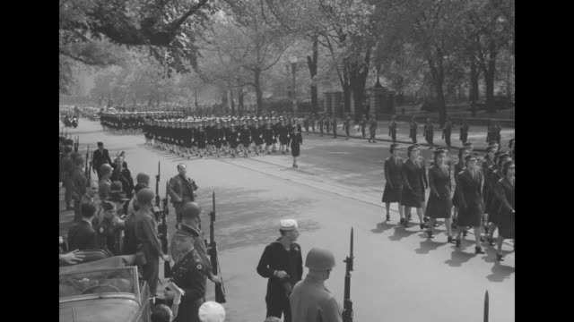us soldiers pass the white house as they march in the funeral procession that is bringing pres franklin roosevelt's coffin to the white house / rear... - pennsylvania avenue stock videos & royalty-free footage
