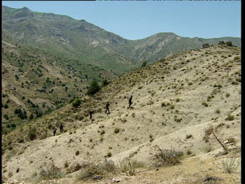 soldiers patrol barren mountainous region uzbekistan - ムラがある点の映像素材/bロール
