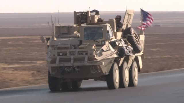 us soldiers patrol in armoured vehicles along the highway known as the international road in syria's northern hassakeh province close to the us base... - army soldier stock videos & royalty-free footage
