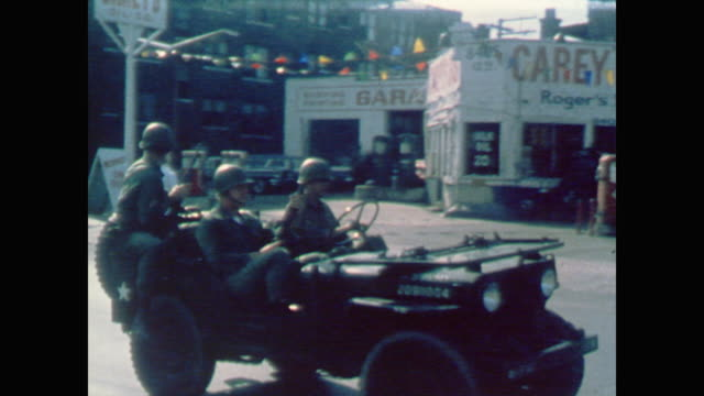 vidéos et rushes de soldiers patrol streets in trucks - 1967