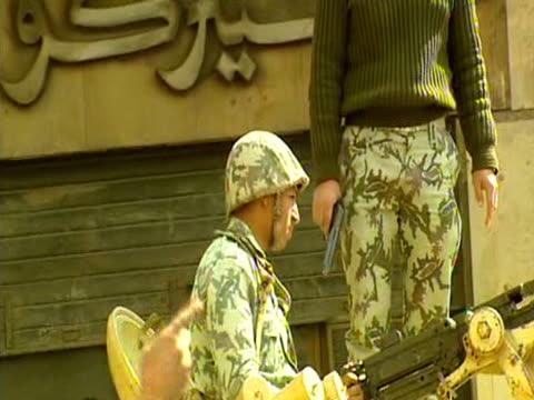 soldiers patrol the streets during an anti-government demonstration cairo - militärisches landfahrzeug stock-videos und b-roll-filmmaterial