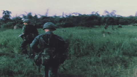 vidéos et rushes de soldiers patrolling through fields and jungle, working with arvn, and finding and destroying viet cong underground bunker / vietnam - conflit