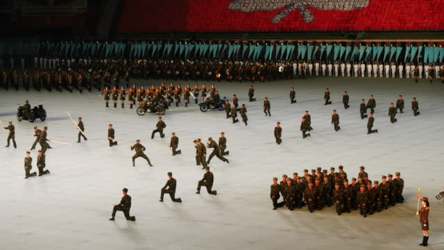 soldiers perfoming fights during mass games in pyongyang, north korea, dprk. medium shot - north korea stock videos & royalty-free footage