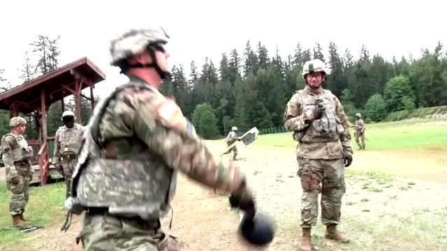 Soldiers perform pushups and run to a shooting range to fire M9 pistols soldier swinging kettle ball before firing pistol May 15 2018 Image courtesy...