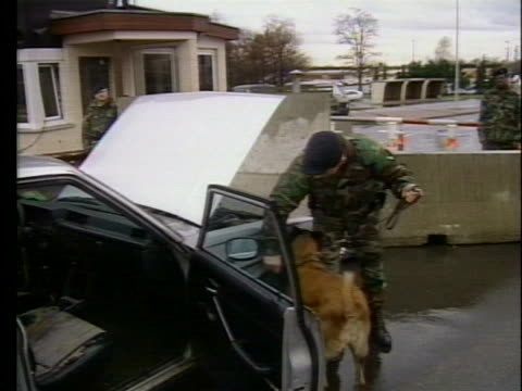us soldiers perform security checks as cars enter an air force base in frankfurt germany on the eve of the persian gulf war - war or terrorism or military stock-videos und b-roll-filmmaterial