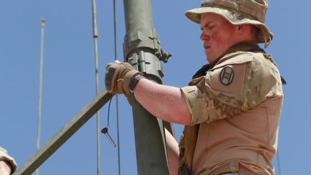 soldiers prepare for operation hickory sting at national training center fort irwin california in readiness for overseas deployment later in the year - infanterie stock-videos und b-roll-filmmaterial