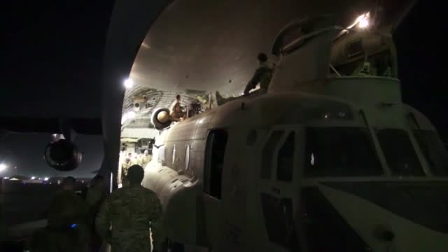 soldiers prepare for the resolute support mission by loading a ch-47f chinook into a c-7 aircraft to send back to the u.s. for reset - bagram air base stock videos & royalty-free footage