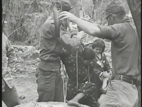 soldiers pulling okinawan child & woman out of well. vs civilian refugees, children, shivering child covered in mud, us soldier giving water from... - pacific war video stock e b–roll