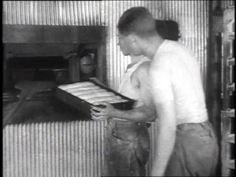 stockvideo's en b-roll-footage met soldiers putting trays of bread dough in large oven / camp sherman chillicothe ohio united states - chillicothe