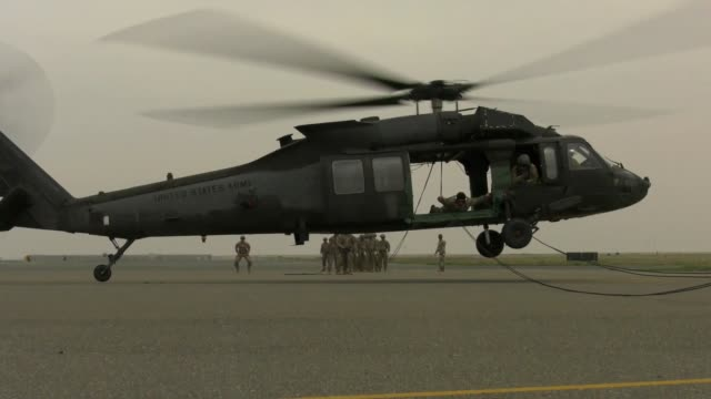 soldiers rappel out of a helicopter during air assault training course at camp buehring, kuwait, february 14, 2019. - military helicopter stock videos & royalty-free footage