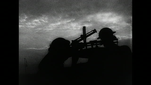 montage soldiers readying searchlights and anti-aircraft guns, firemen and air raid wardens standing by, and hand turning on the air raid siren / london, england, united kingdom - allied forces stock videos & royalty-free footage