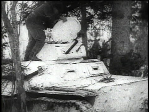 soldiers remove camouflage from mobile artillery / ranks moving through woods - 1941 stock-videos und b-roll-filmmaterial