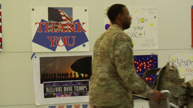 soldiers returning home from iraq and afghanistan on march 21 2012 in baltimore md - young war veteran stock videos & royalty-free footage