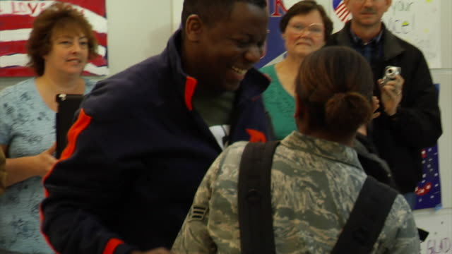 soldiers returning home from iraq and afghanistan on march 21, 2012 in baltimore, md - ホームカミング点の映像素材/bロール
