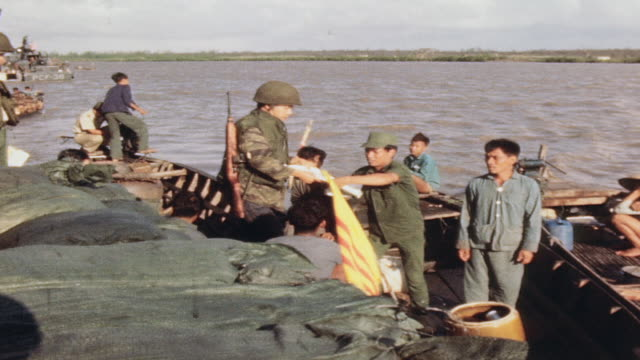 soldiers returning paperwork to cleared sampan fishermen at mobile river security checkpoint / vietnam - sampan stock videos & royalty-free footage
