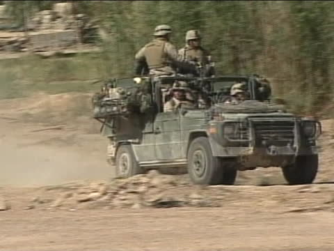 soldiers ride in humvees. - al fallujah stock videos & royalty-free footage