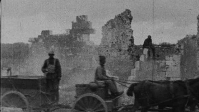 soldiers ride past destroyed village / france - 1917 stock-videos und b-roll-filmmaterial