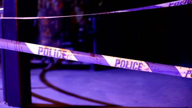 vídeos y material grabado en eventos de stock de soldiers rip down crime scene tape in dark building no - noreste de inglaterra