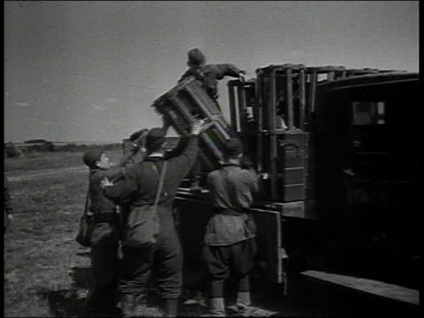 soldiers rolling ammo away from truck - unloading stock videos & royalty-free footage