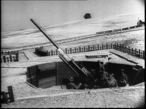soldiers run across a field toward a building and roll the structure away along tracks / gun nest revealed underneath / top of haystack being removed... - haystack stock videos & royalty-free footage