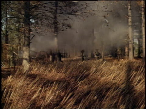 1967 montage soldiers running in drills, men in straw hats representing the enemy hiding in trap doors in the ground / fort campbell, kentucky - fort campbell video stock e b–roll