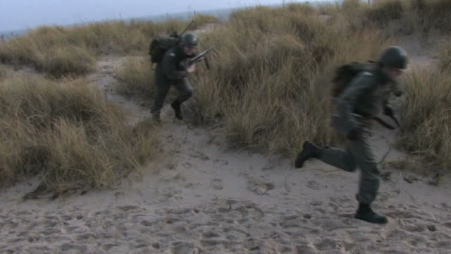 soldiers running on the beach steadycam shot - army exercise stock videos and b-roll footage