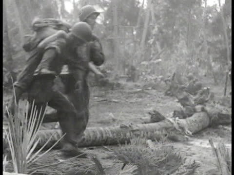 soldiers running through tropical foliage clearing soldiers carrying wounded man on back soldiers moving through tropical clearing ms radioman using... - battle stock videos & royalty-free footage