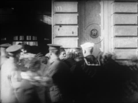 B/W 1920 soldiers sailor guiding Greek refugees in street fleeing from Turkey / newsreel