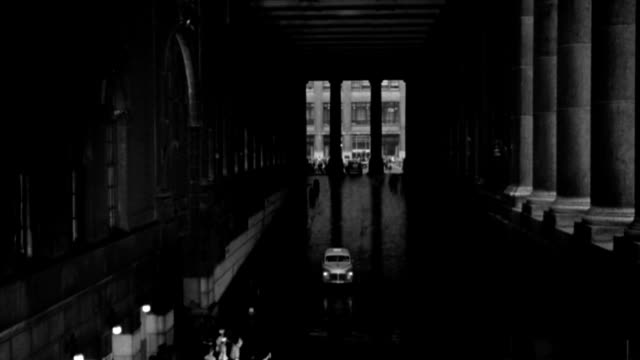 soldiers, sailors, and civilians mill around a grand central station taxi ramp in a vintage film. - 1958 stock videos & royalty-free footage