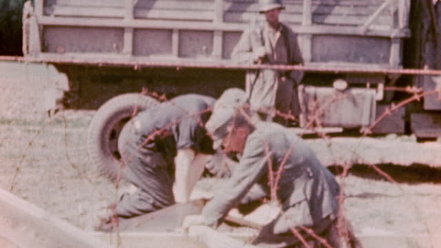 HA Soldiers sawing wood under armed guard / Germany