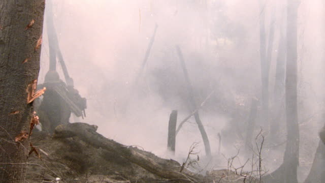 soldiers scatter as smoke fills a vietnam hillside. - 1987 stock videos & royalty-free footage