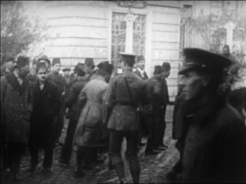 B/W 1920 soldiers scattering crowd of people during Greeks' flight from Turkey / newsreel