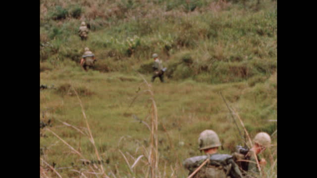 soldiers search and clear field during vietnam war in 1969. sequence of shots. - vietnam stock videos & royalty-free footage