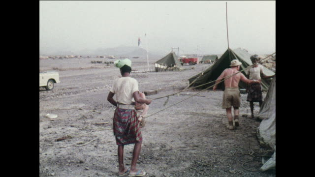 montage soldiers set up a water supply in the mountains / aden, yemen - aden stock videos & royalty-free footage