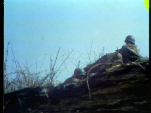 soldiers shoot from a hill in the battle for highway 13 near an loc in south vietnam. - south vietnam stock videos & royalty-free footage