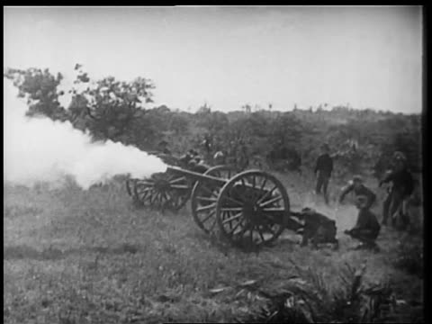B/W 1898 REENACTMENT U.S. soldiers shooting off cannons in Spanish-American war / documentary