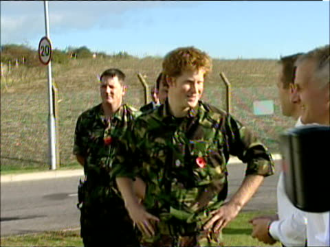 soldiers showing prince harry around during his visit to royal navy bomb disposal unit on hornsea island on october 31 2007 / portsmouth england /... - 20 24 years stock videos & royalty-free footage