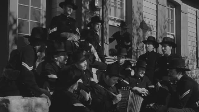 ms soldiers singing on porch - 歌う点の映像素材/bロール