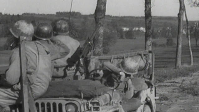 soldiers sitting in jeep beside m2 browning machine gun lookout with binoculars staring into the distance / france - machine gun stock videos & royalty-free footage