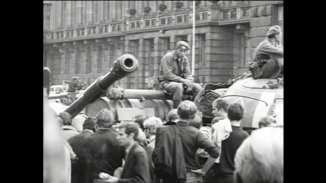 soldiers sitting on tanks passing by crowd during the soviet invasion of czechoslovakia; multiple views of people crowded on truck passing by holding... - prague stock videos & royalty-free footage