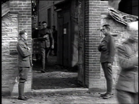 soldiers, some injured, carrying a casket draped with an american flag in a funeral procession / france - 1918 stock videos & royalty-free footage