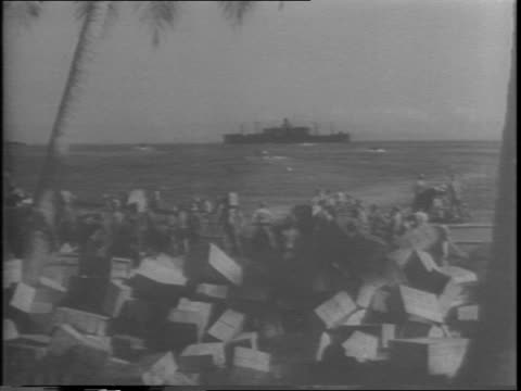 soldiers sort through boxes on the beach ship in the distance palm trees / closeups of boxes of canned food such as cherries and tomato juice /... - tomato juice stock videos and b-roll footage