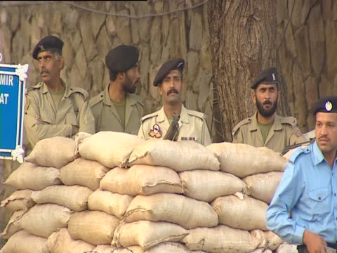 soldiers stand behind a sandbag wall in islamabad as traffic passes by - sandbag stock videos & royalty-free footage