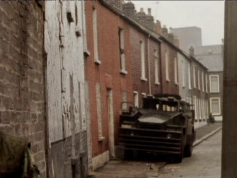 Soldiers stand on street corners Falls Road 1974